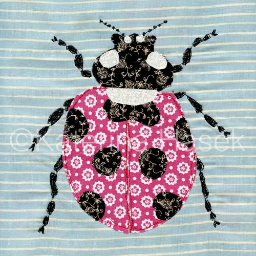 An applique image of ladybird