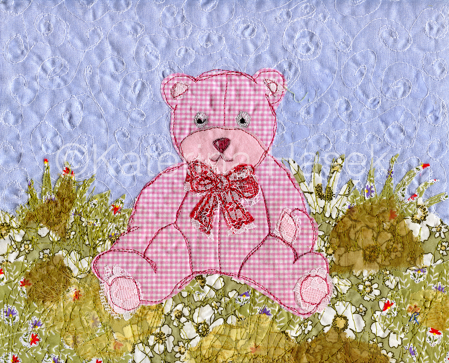 An applique image of pink teddy