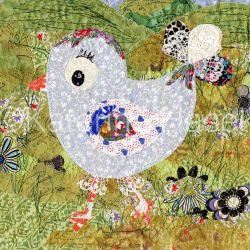 An applique image of little cartoon bird