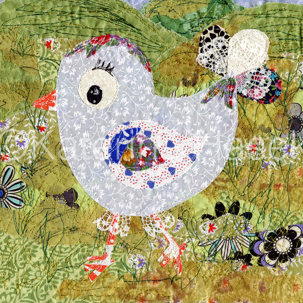 An applique image of little cartoon bird
